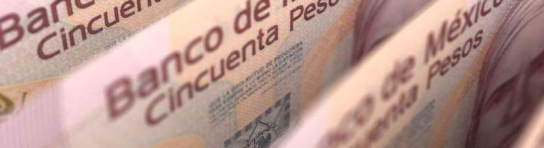 El dólar se dispara a los 21.10 pesos en bancos